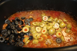 Add the olives to the chicken