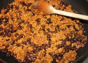 Mix ground beef and black beans