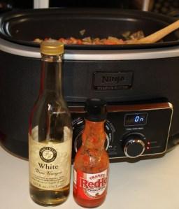 White wine vinegar and hot sauce, optional