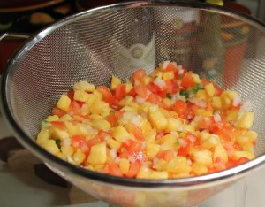 Drain pineapple and tomatoes
