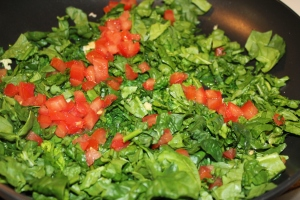 Saute spinach garlic tomatoes