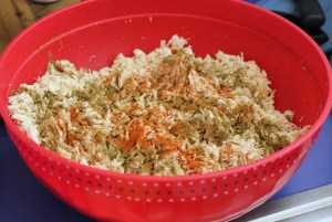 Add cumin and cayenne to shredded chicken