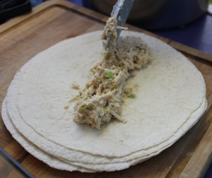 Place chicken mixture on tortilla