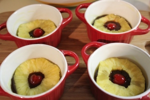 Place pinapple and cherry in ramekin