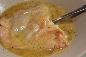 Dip chicken in egg mixture