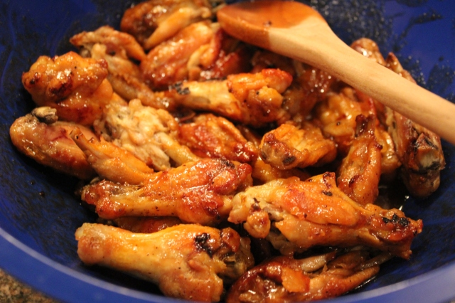 Coat wings with sauce