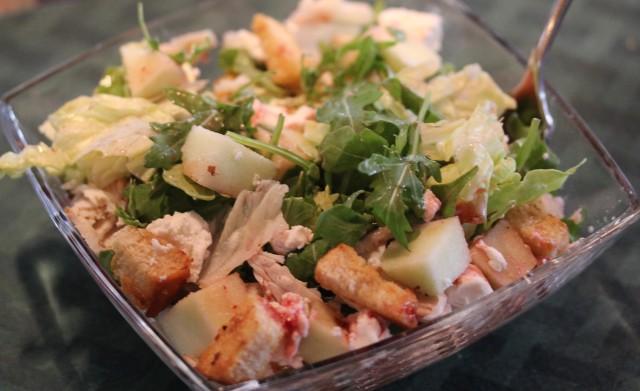 Kel's salad with arugula, turkey, goat cheese, apples, etc.