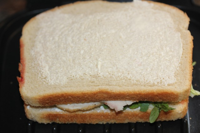 Spread sandwich with butter