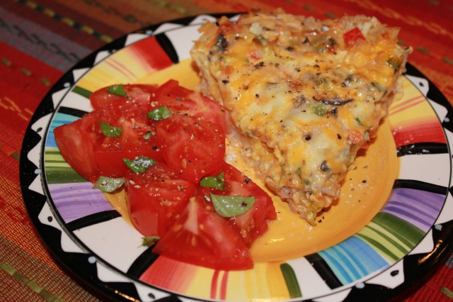 Kel's hash brown quiche served with tomatoes
