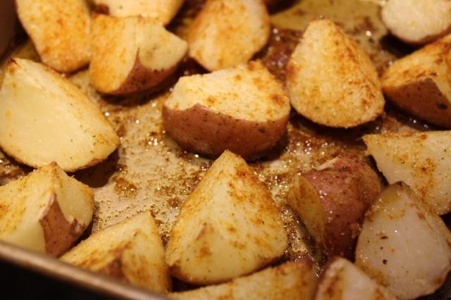 Flip potatoes halfway through roasting