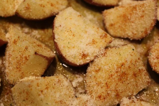 Season potatoes with garlic salt, cayenne and parmesan
