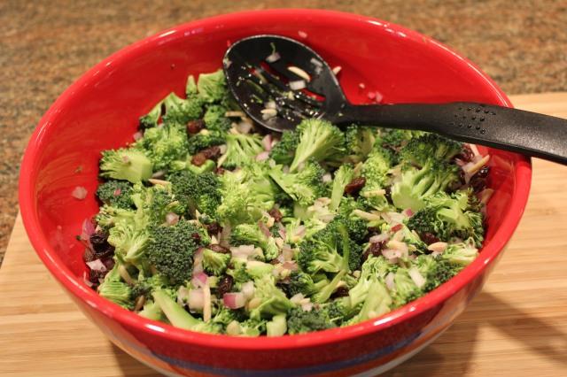 Mix together broccoli, almonds, raisins, onion, lemon juice