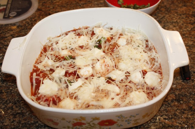 Add cheeses to eggplant and marinara