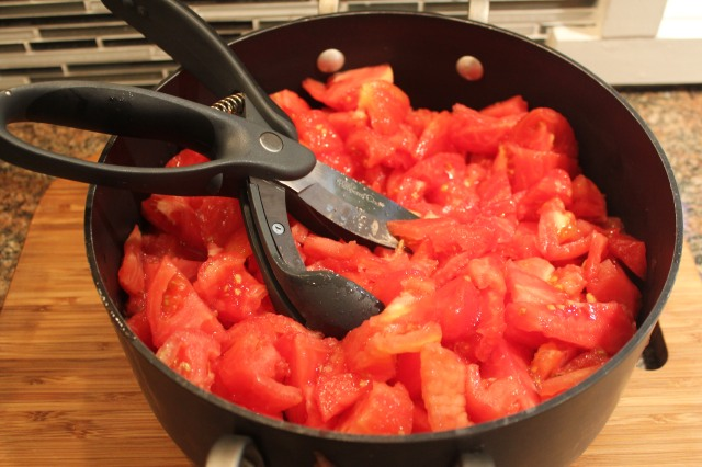 Chop up tomatoes for the marinara sauce