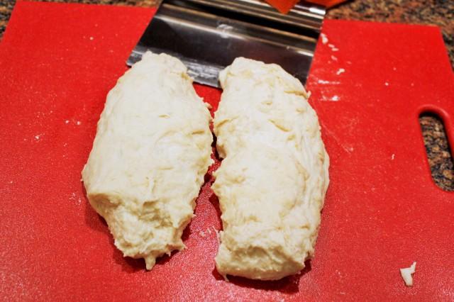 Cut dough in half