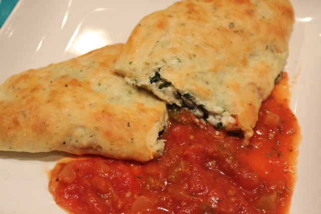 Dip calzone in Kel's spicy marinara