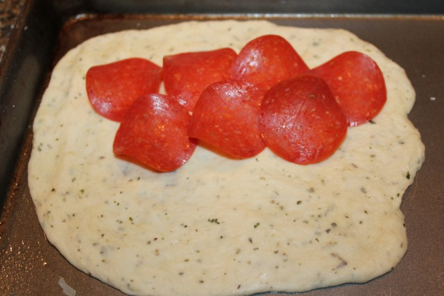 Place pepperoni on flatbread