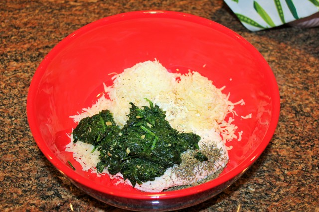 Place spinach, cheeses, etc. in large bowl