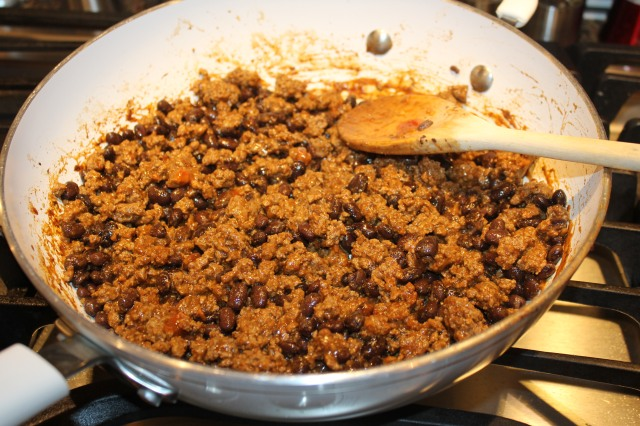 Add beans and taco seasoning to ground beef