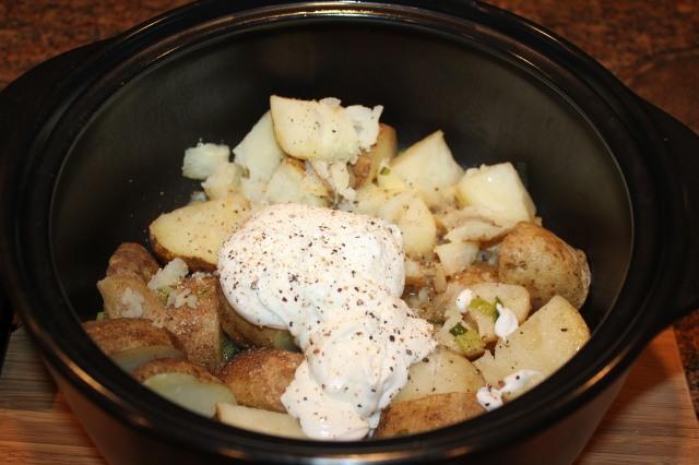 Add yogurt to cooked potatoes