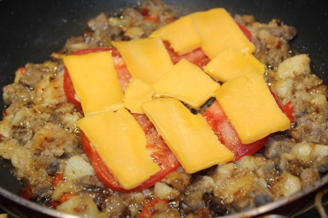 Add tomatoes and cheddar to hash