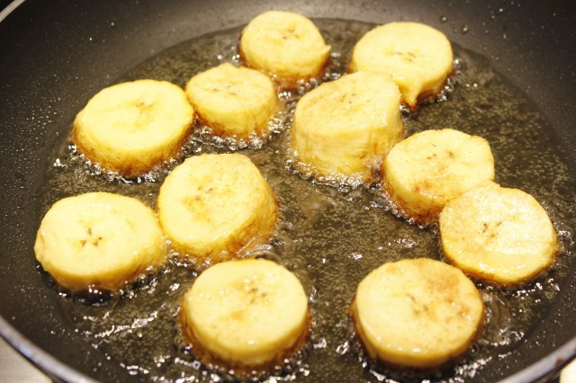 Place plantain slices in skillet