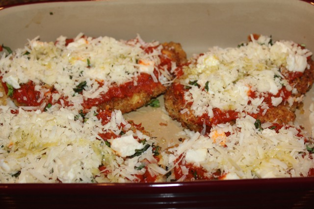 Sprinkle chicken with cheeses and basil