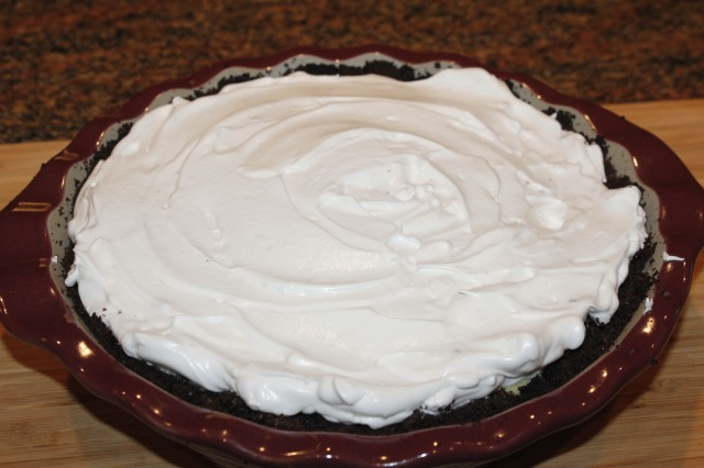 Spread meringue on pie