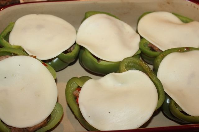 Cover peppers with provolone