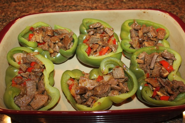 Stuff peppers with cheesesteak mixture