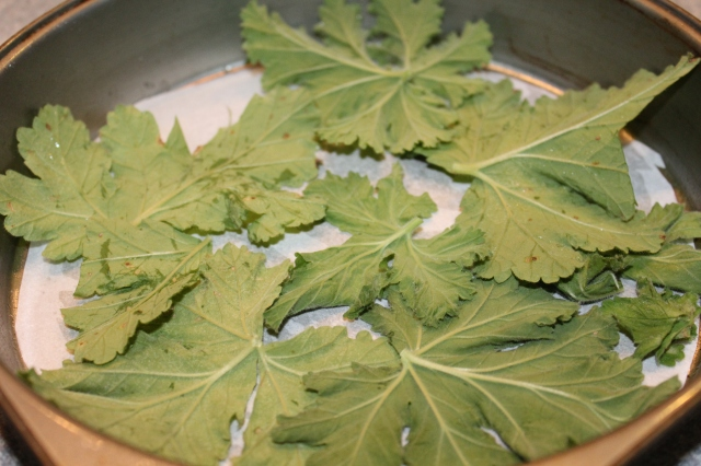 Place geranium leaves on top of parchment paper