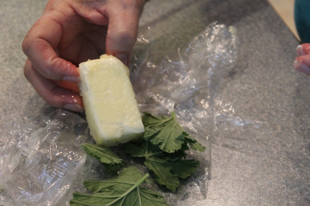 Remove rose geranium leaves from butter