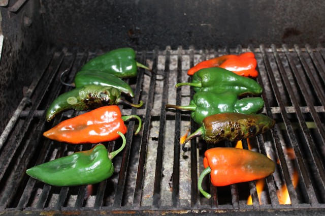Char peppers on grill