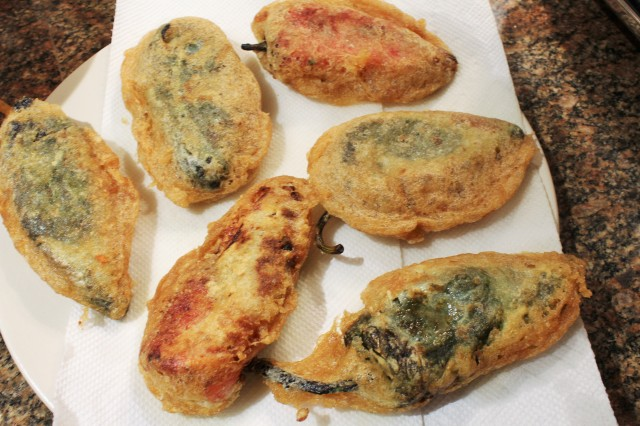 Drain chile rellenos on paper towels