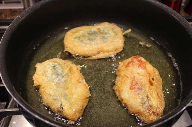 Saute chile rellenos until golden brow.