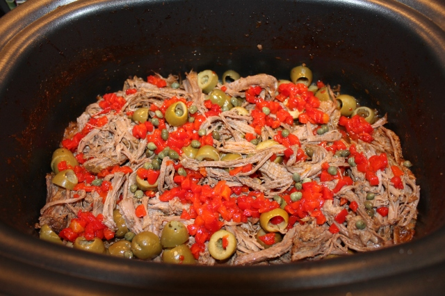 Add olives, pimentos, capers, etc. to shredded beef