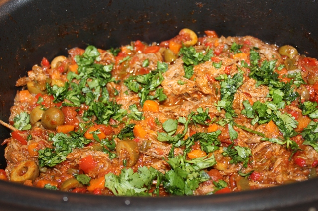 Garnish Ropa Vieja with cilantro