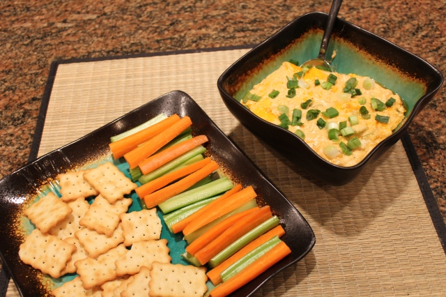 Serve Kel's buffalo dip with veggies and crackers