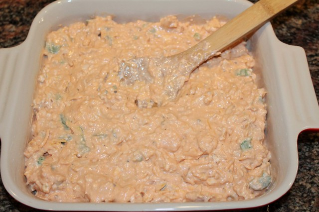 Spread buffalo chicken dip in shallow baking dish