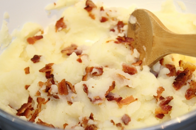 Add bacon to potatoes