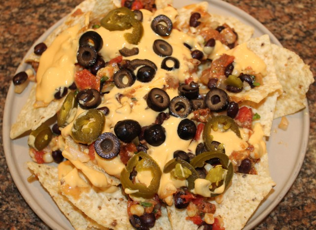 Layer nachos with filling, queso, etc.