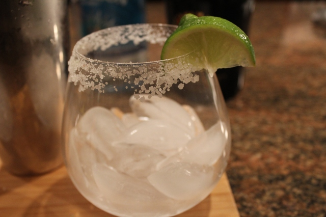 Rim glass with salt and add ice