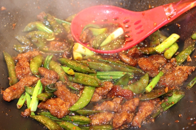 Add green onions and season with red pepper flakes