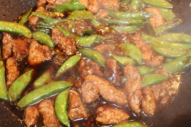 Add sauce to beef and snow peas