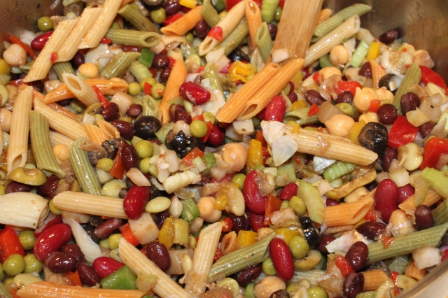 Add marinade to bean and pasta salad
