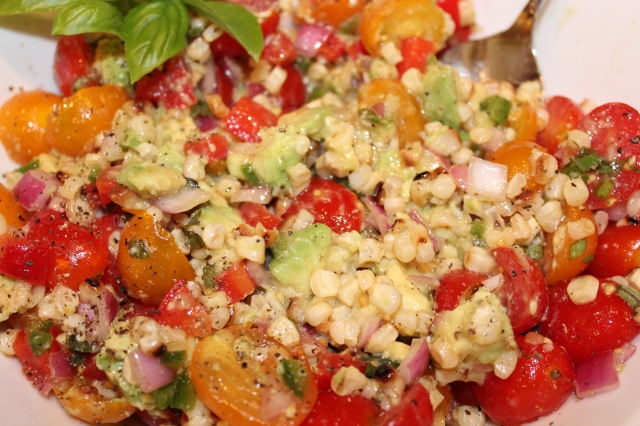 Fold in avocados to tomato and corn mixture