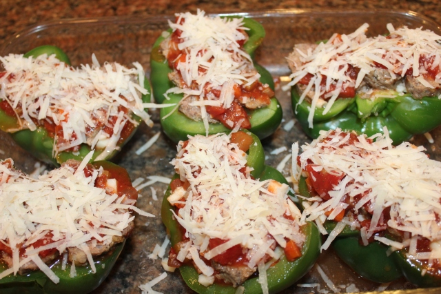 Sprinkle peppers with parmesan romano