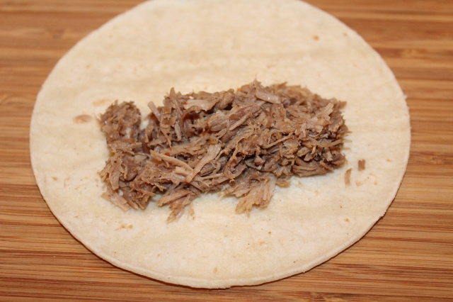Place pork on corn tortilla