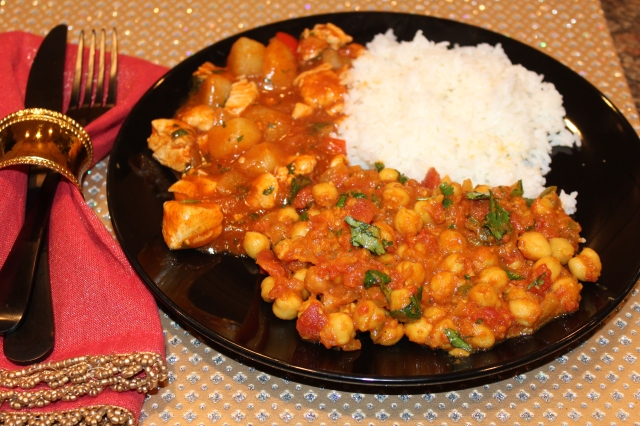 Serve Kel's chana masala with chicken vindaloo and rice
