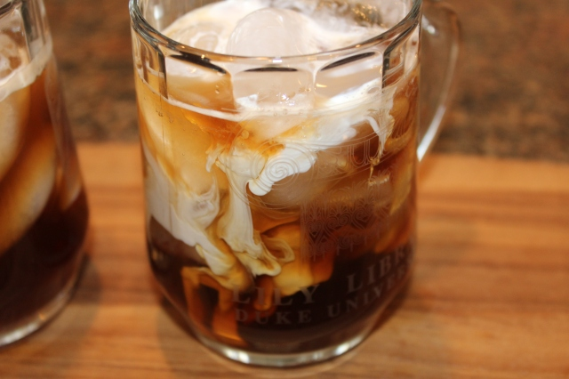 Slowly add cream to coffee mixture